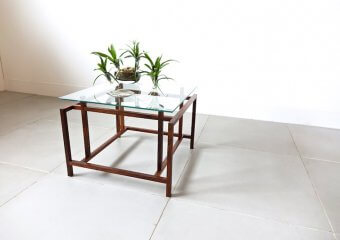 Glass top table by Henning Norgaard